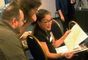 "Photo credit: Charles Minshew/KOMU, via Flickr. ""Columbia residents discuss EEZ concerns: Columbia resident Shari Korthuis (right) discusses the latest version of a map of the city's Enhanced Enterprise Zone with Nancy Wood and Jeff Memmer at a meeting at Parkade Center in Columbia, Mo., on Wednesday, March 14, 2012."""
